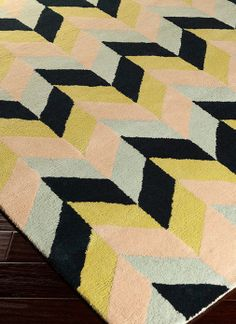 OMG these colors! celery green, onyx, butter, peach & ice blue! soothing & striking! Chevron rug