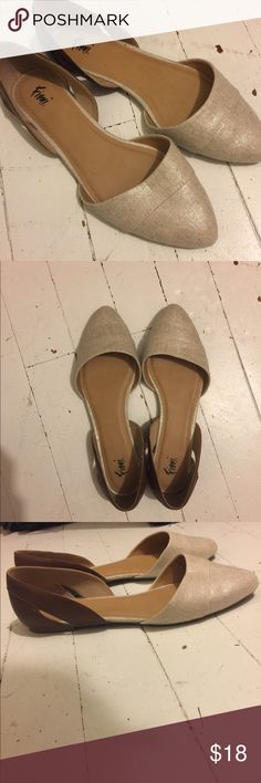 Women's brown/tan flats size 12 wide These flats are Fioni brand from Payless. Never worn, nothing wrong with them they just didn't fit my feet correctly. Size 12 wide. Brown back with tan/goldish pointed toe Payless Shoes Flats & Loafers