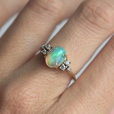 Very special and unique oval shaped opal ring with diamond on both sides#capucinne  Tap here ---> @capucinnejewelry to enter the shop and don't forget to follow if you want to see new products   #fashion #trend #jewelry #style #photogram #truelove #love #beautiful #engagement #wedding #ring #gold #etsy #diamond #handmade #jewelryjournal #elegant #unique #artofdiamonds #special #simple #madeofjewelry #artofdiamonds #etsy #oval #opal
