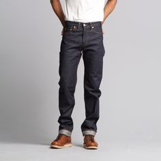 These Raw LVC 1954 501Z jeans are the first 501 to be influenced by the western look with a wider thigh and a tapered leg. They feature the classic 5-pocket styling with a zip fly and still are shrink