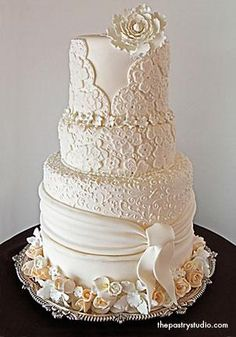 This custom designed cake was inspired by a bride's couture wedding gown