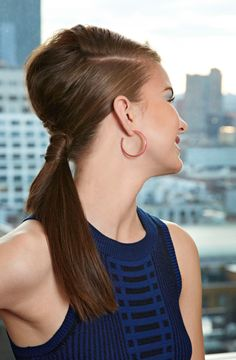 Tease your crown before pulling your hair back for a modern bouffant.