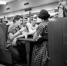 at the soda shop in the 50's