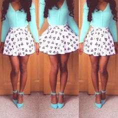 Long sleeve turquoise button down shirt, a black and white patterned skirt, and turquoise heels.
