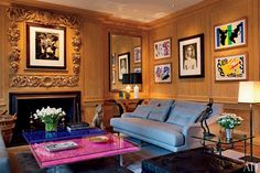 Trudie Styler, tapped Lee F. Mindel to renovate their London house. Matisse prints and, above the fireplace, a Picasso are in the living room. The low tables are by Yves Klein; a Barry Flanagan bronze is on the Diego Giacometti side table. Yves Klein, Architectural Digest, Home Fireplace, Living Room With Fireplace, Giacometti, Trudie Styler, London Townhouse, Celebrity Houses, Celebrity Guys