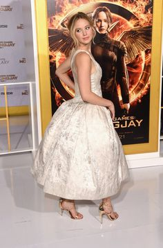 Pin for Later: Can't-Miss Celebrity Pics!  Jennifer Lawrence struck an over-the-shoulder pose at the LA premiere of Mockingjay on Monday.