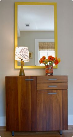Painted yellow mirror - find an oval mirror and paint same color as sidetable. This wood is close to our entry shelf.