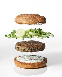 These veggie burgers get their rich, earthy flavor from mushrooms and nutty quinoa, and are topped with sharp radish sprouts and cool cucumbers. Greek yogurt is a zesty Mediterranean replacement for ketchup. Serve these with our Golden-Beet Salad as a side dish.