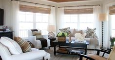 like the look of bamboo shades with white curtains.