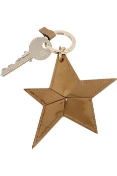 Mulberry's star-shaped leather keychain comes in an eye-catching gold hue - perfect with the matching 'Lily' bag. It's finished with a loop and ring fastening so you can switch up your styling. The elegant presentation box makes it perfect for gifting. Shop it now at NET-A-PORTER.COM #Mulberry