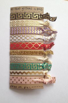All That Glitters is Gold -- Specialty Prints Creaseless Hair Ties | 5 pack --> Love this pack of gold shimmery/sparkly creaseless hair ties!