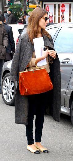 Red bag, grey coat, cap toe ballet flats, camel sweater