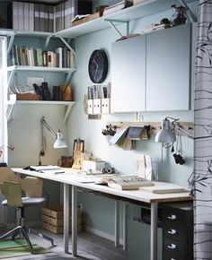 I like the use of the shelves from the window to the corner, while still leaving the desk open - would be great for our corner. Also, the desk lamps attached to the wall is a must-do.