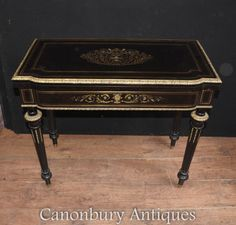 - Gorgeous French Empire ebony games table with intricate metal inlay<br /> - The inlay work is in the Boulle manner made from brass featuring floral motifs and arabesques<br /> - Classically refined look with fluted legs and original ormolu mounts<br /> - Table top opens out to reveal the green bieze games playing surface, perfect for cards or bridge<br /> - Handsome and unique piece purchased from a dealer on Marche Biron at Paris antiques market...