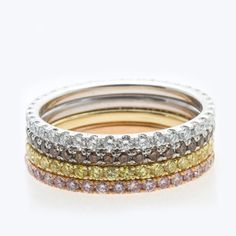 Set of four natural color diamond eternity rings.