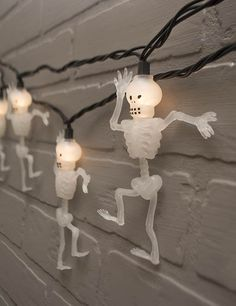 Celebrate Halloween with our dancing skeleton string lights! Warm white lights illuminate 10 white skeletons, each 5 inches tall and spaced 10 inches apart.