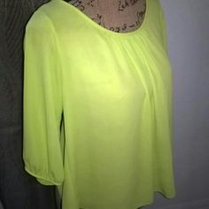 Loose fitting flowy top Brand-new with out tag Never worn Long sleeves with back out Dressy but sexy top Tops Blouses