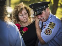 Claire Rayburn consoles West Texas firefighter Eddie Hykel as he is overcome with emotion as the names of the fallen first responders are read during a memorial service in Austin honoring volunteer firefighters who died in the line of duty. The 2015 First Responder Legislative Day and Memorial Service brought first responders from around the state.  Ricardo B. Brazziell, Austin American-Statesman via AP