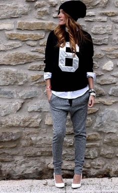 Shop this look on Lookastic:  http://lookastic.com/women/looks/beanie-crew-neck-sweater-dress-shirt-bracelet-watch-sweatpants-pumps/8521  — Black Beanie  — Black and White Print Crew-neck Sweater  — White Dress Shirt  — Silver Bracelet  — Silver Watch  — Grey Sweatpants  — White Leather Pumps