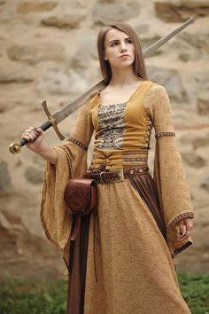 Medieval dress & top This outfit is of medieval inspiration and it has 3 items: - the dress with very large and long sleeves made of cotton&wool fabric -the top that closes on the sides and back with leather string. The top is made of yellowish velvet and cotton with baroque