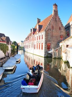 """To cruise in a small boat along the canals of Bruges, Belgium, known as the """"Venice of the North""""."""