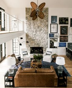 Lauren Liess Lake House: The great room's stone fireplaces is one of the few original features Liess kept intact. Photograph by Helen Norman.