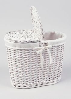 White wicker is a fantastic way to lighten up your bathroom. This split willow toilet roll storage basket is perfect for discretely storing any spare toilet...
