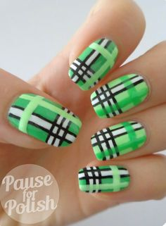 Fresh looking greens! This nail art design uses a mint green polish as base coat topped with black, white and light green stripes to create a plaid effect.