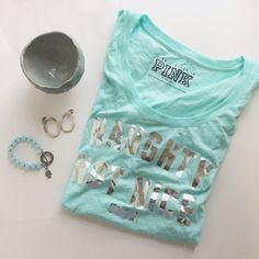 """Like New Aqua Teal Naughty Not Nice Top This Victoria's Secret top featuring the phrase """"Naughty Not Nice"""" in silver metallic lettering is perfect for any season! It is like new and is a size XS but could also fit a small! It is intended as a sleep top, but could easily be just a normal top! Check it out! PINK Victoria's Secret Tops Tees - Short Sleeve"""
