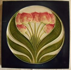 Art Nouveau Jugendstil Tulips Antique Tile. Here is a wonderful art nouveau Jugendstil ceramic tile with a raised tulips motif in pink, greens and blue, made in Germany by Muegeln.