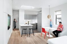 """Since the main living space has to function as both a bedroom and a family room, Krastev and Nikolova make do without a couch. When the family watches TV or reads, they cozy up on the bed or sit on the built-in bench, which also serves as a dining and play area. """"When in a limited space, you have to really think: What do we do in this room, what do we need?"""" says Krastev. """"Do we really need a coffee table?"""" In their case, the answer was no."""