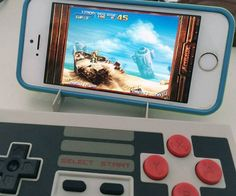 Bluetooth NES Gaming Controller  Play all favorite smartphone games the way they were meant to be played with the Bluetooth NES gaming controller. The iconic controller is back and better than ever as it seamlessly combines vintage controls with todays modern handheld devices.  $34.99  Check It Out  Awesome Sht You Can Buy