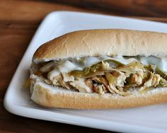 """Slow Cooker Chicken Philly Sandwiches Recipe. I (Abby) made this for my family and it was so good that my husband was wishing he could have it again for a midnight snack. I used a more natural ingredients sauce, and doubled the amount and doubled the onions. Use fresh """"sub buns"""", slice and butter them, then toast them under the broiler. Add your chicken mixture and spoon some of your broth over that side of the bun. Top with two pieces of mozzarella and place back under the broiler until…"""