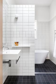 White tile bathroom and bathroom flooring tile with black ceramic floor tile plus floating sink will complement decorating small bathroom White Subway Tile Bathroom, Small Bathroom Tiles, Bathroom Toilets, Simple Bathroom, Bathroom Layout, Bathroom Flooring, Shower Tiles, White Tiles, Shower Floor