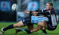 Melbourne Rebels' James O'Connor is on the receiving end of a Waratahs hit