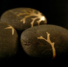 Gold leafed rocks. This would be a fun project to do for Christmas with pine trees or snowflakes.