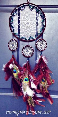 Peacock Dreamcatcher With Beads | DIY dreammcatcher | Ideas & Inspiration, see more at https://diyprojects.com/diy-dreamcatcher-ideas-instructions-inspiration