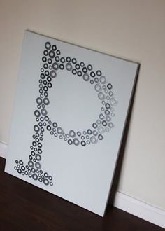 Wall art on the cheap! Love this initial made from washers.