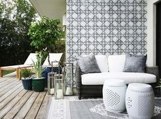 Gorgeous tiled feature wall presents nicely with outdoor daybed.