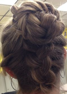 Dutch braid up the back with fishtail top knot! Cute.