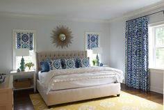 Yellow and blue bedroom with light blue walls and windows covered in Thom Filicia Prospect Fabric in Lake, by Nightingale Design.