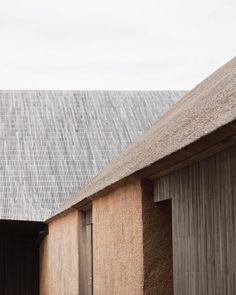 Our PS18 Campaign was shot on the newly opened Wadden Sea Centre in the western part of Denmark. Around 12.000 years ago the end of the ice age created the 500 km long coastal area known as the Wadden Sea. The Wadden Sea Centre has been erected with thatched roofs and facades paying homage to the regional material and traditional craftsmanship. #norseprojects Scandinavian Architecture, Wood Architecture, Architecture Details, Minimal Photography, Thatched Roof, Colour Pallete, Wooden House, House In The Woods, Cladding