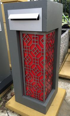 Charcoal Medusa Letterbox with red Perspex and laser cut screen - modern front plate