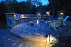 Boulder lined fire pit with stone patio