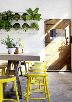 Discover more of the best Yellow, Industrial, Stool, Remodelista, and Interior inspiration on Designspiration Deco Design, Cafe Design, House Design, Deco Restaurant, Restaurant Design, Organic Restaurant, Yellow Restaurant, Rue Verte, Industrial Stool
