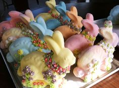 Easter Bunny Sculpture. Lovingly handcast using vintage molds and decorated with a profusion of royal icing flowers.
