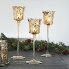 An ornate golden swirl and champagne-colored stems add elegance to our trio of glass candle holders. PartyLite Gala Stemmed Votive Trio