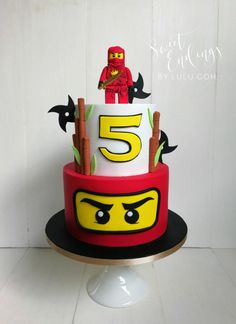 A clean and simple Ninjago Kai cake, with fondant shuriken! Lego topper handmade… A clean and simple Ninjago Kai cake, with fondant shuriken! Lego topper handmade, all fondant. Bolo Ninjago, Bolo Lego, Lego Ninjago Cake, Ninjago Kai, Ninjago Party, Ninja Birthday Cake, Ninja Cake, Ninja Birthday Parties, 4th Birthday