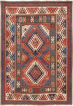 Kazak Rug, Caucasus, Circa 1900 - Boldly colored & intricately decorated, this antique Kazak rug creatively uses a limited number of modular motifs to create a stacked lozenge medallion, formal borders & complementary emblems that embellish the composition. Interlocking latch hook details create an impressive counterchange pattern using contrasting colors while minute protection symbols decorate the vividly colored field. Size: 4 ft 10 in x 7 ft