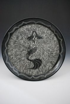 INCREDIBLE stuff.  Check out her website and etsy shop!  Rebecca A. Grant Ceramics: Sgraffito Mermaid Plate
